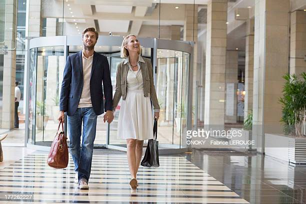 Smiling couple walking at an airport