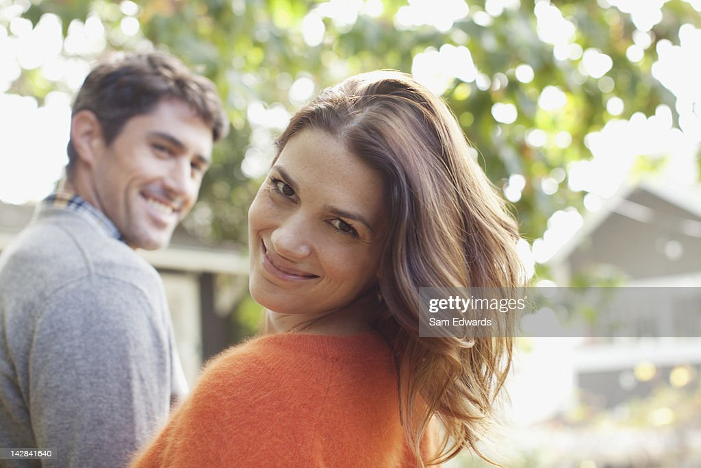 Smiling couple walking outdoors : Stock Photo