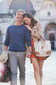 Smiling couple walking through town square