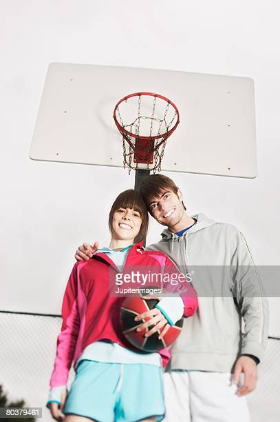 Smiling couple with basketball
