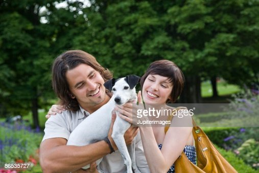 Smiling couple with dog