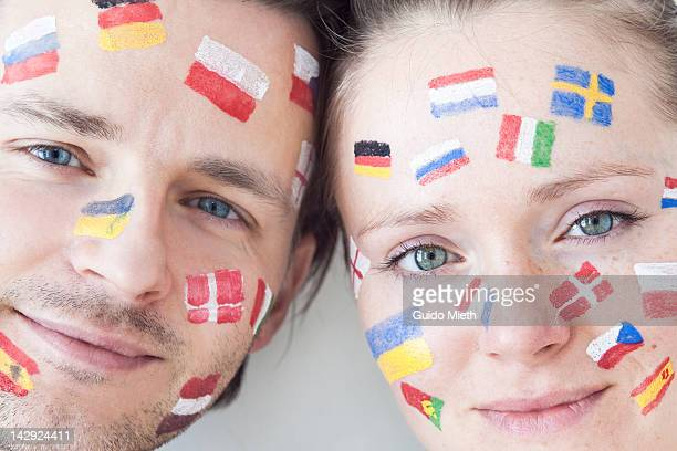 Smiling couple with flag paintings