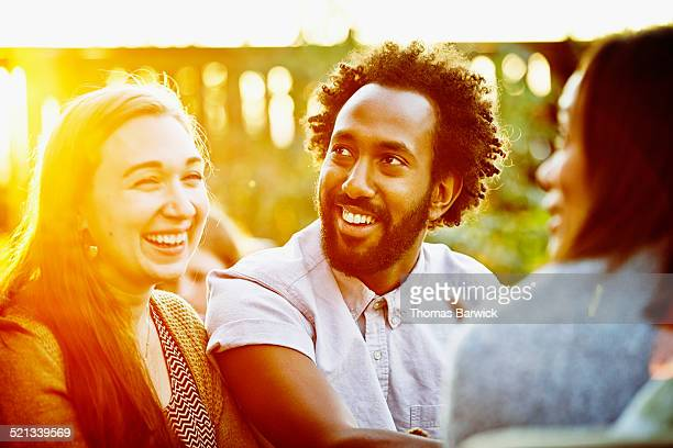 Smiling couple with friends during party