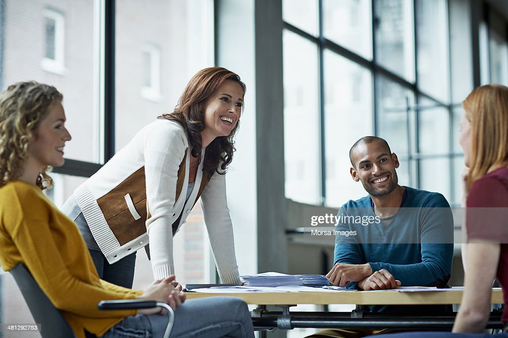 Smiling coworkers in meeting