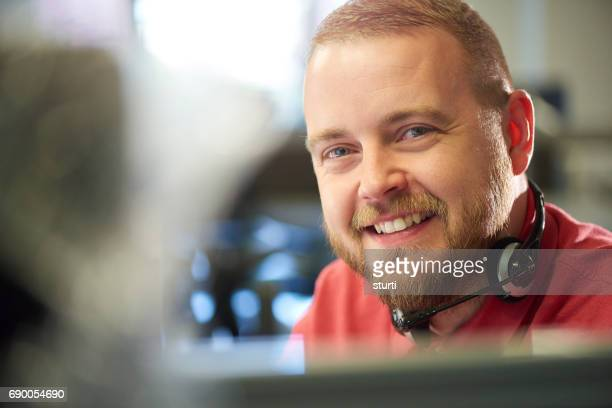 smiling customer service representative looking to camera