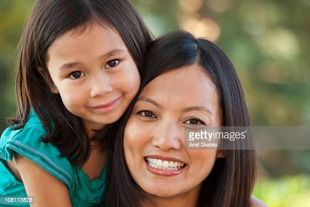 Smiling daughter hugging mother