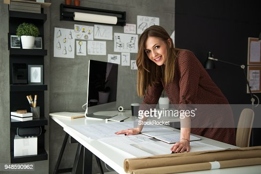 Smiling designer in her studio : Stock Photo