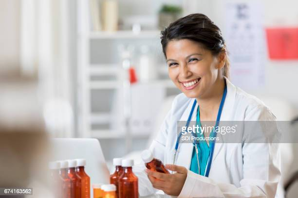 Smiling doctor reviews patient's medication