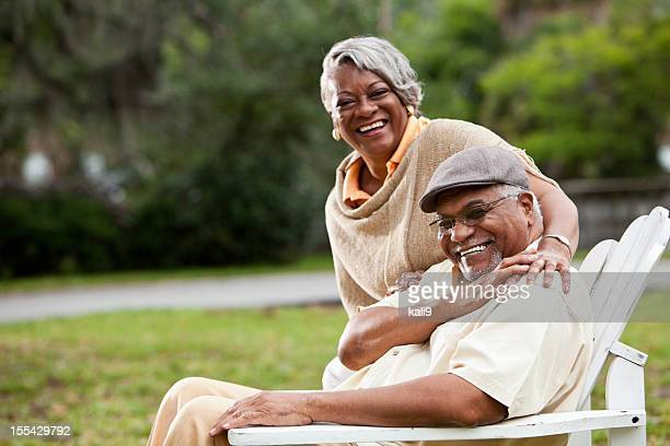 Smiling elderly African-American couple in park