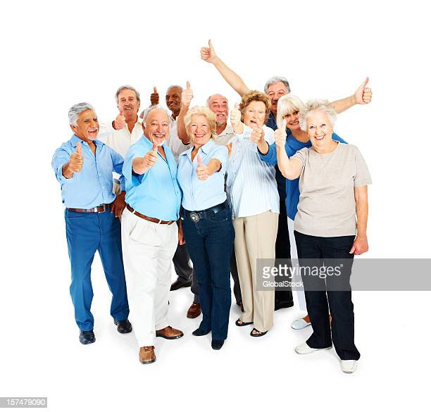 10 smiling elderly men and women showing thumbs up