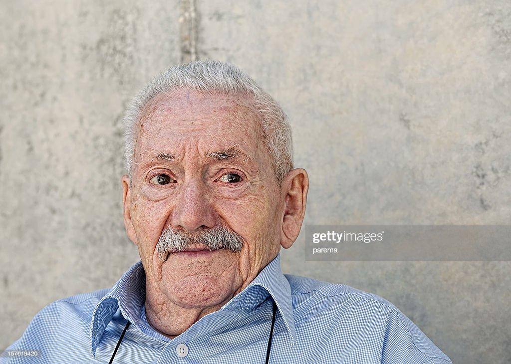 Smiling elderly men : Stock Photo