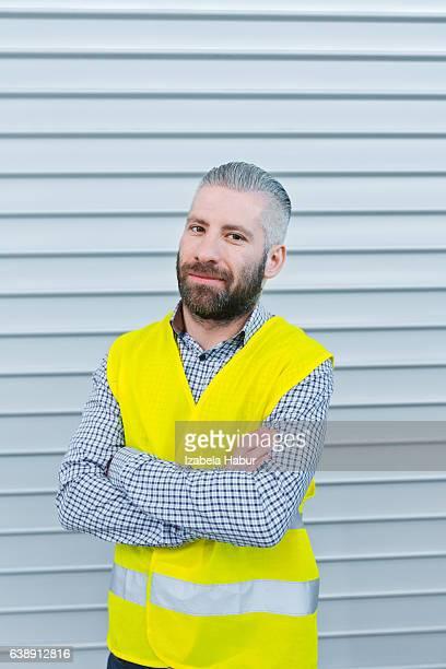 Smiling engineer in front of metal door