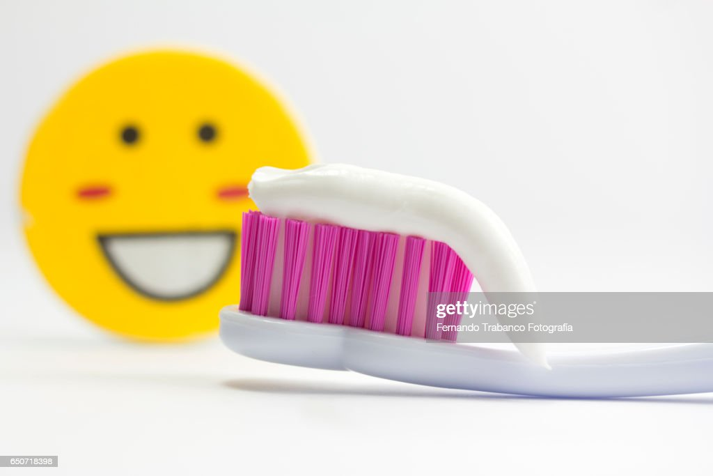Smiling face and toothbrush with toothpaste : Stock Photo