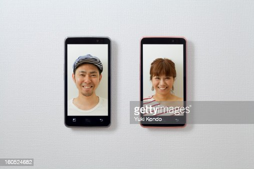 Smiling faces and a smart phones.