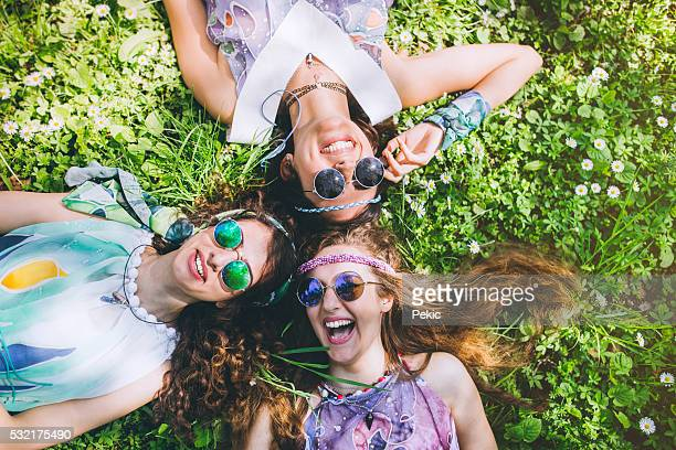 Smiling faces of hippie female friends