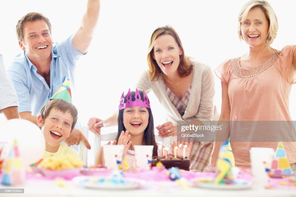 Smiling family celebrating a birthday party : Stock Photo