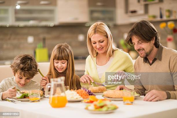 Smiling family having lunch together at home.