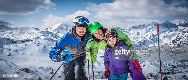 Smiling family portrait on ski slope