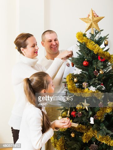 Smiling family preparing for Christmas : Stock Photo