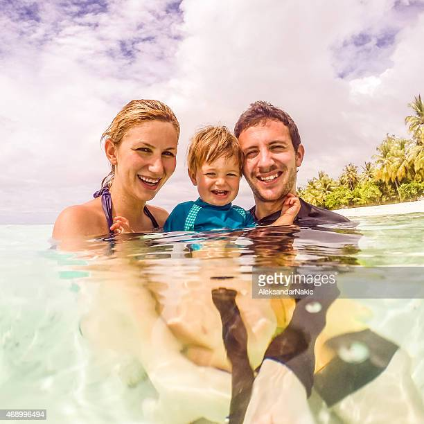 Smiling family selfie in the sea