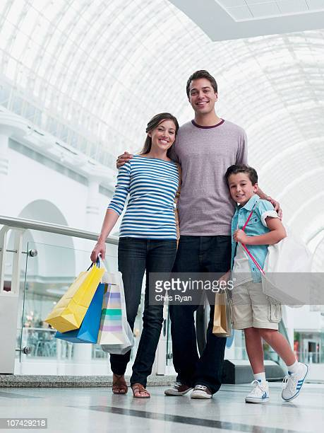 Smiling family shopping together in mall