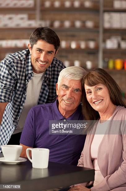 Smiling family sitting in cafe