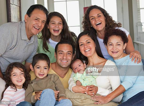 Smiling family sitting together