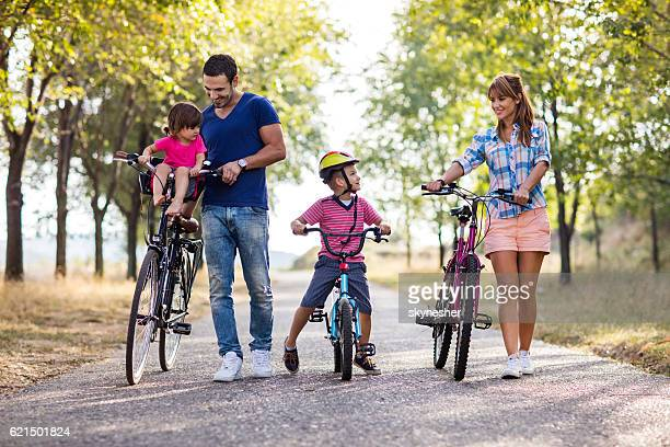 Smiling family spending a day in nature with bicycles.