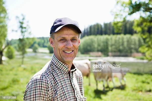 Smiling farmer looking at camera