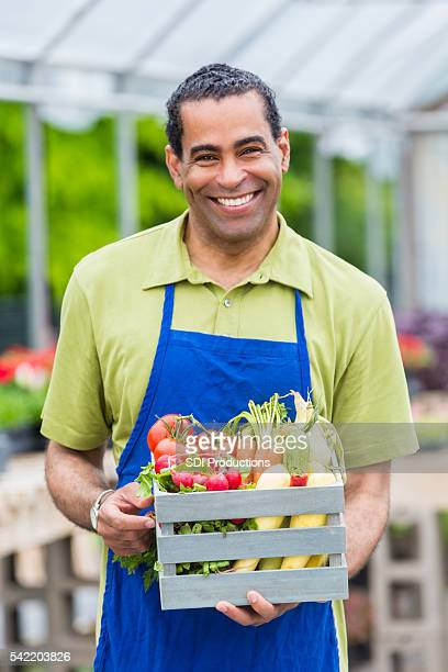 Smiling farmer with fresh produce