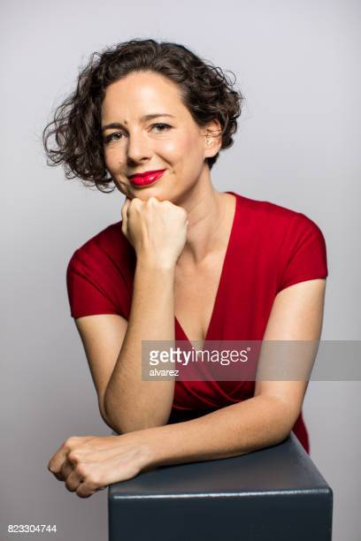 Smiling Fashionable Woman With Hand On Chin