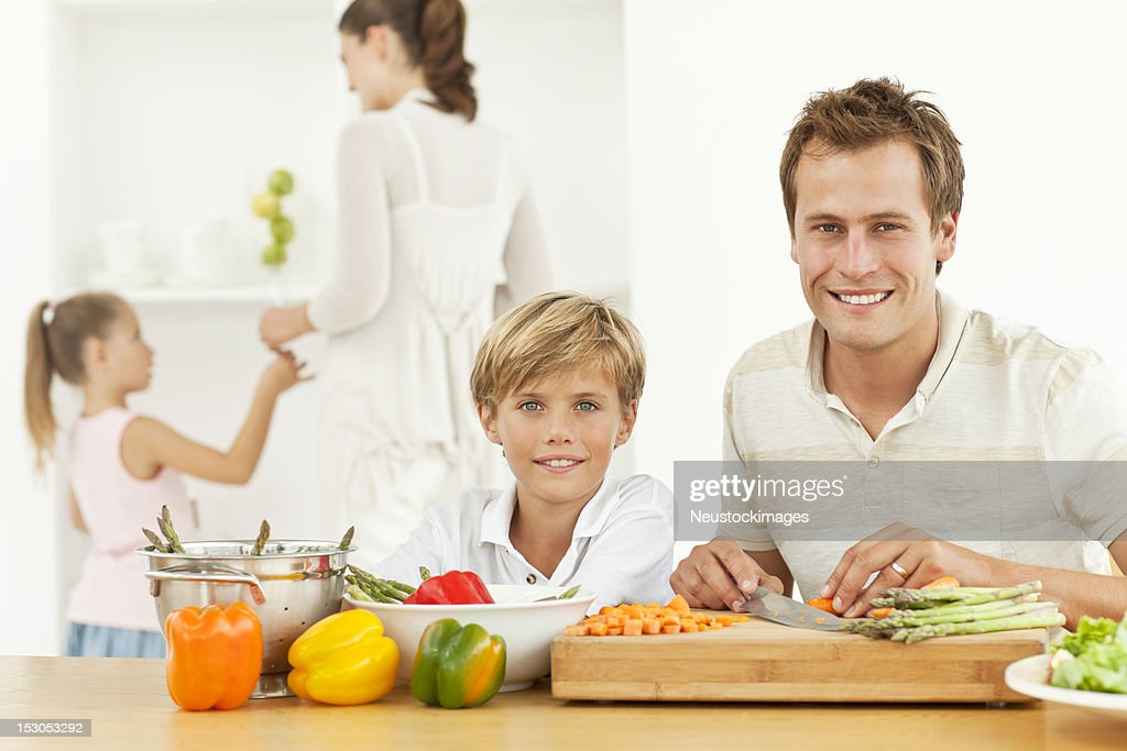 Smiling Father And Son Preparing Food : Stock Photo