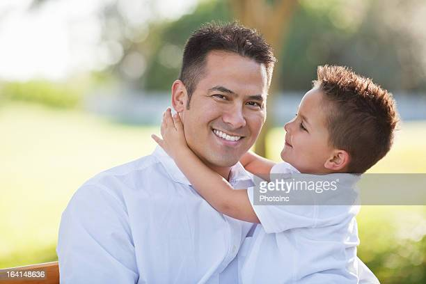 Smiling Father With Son At Park