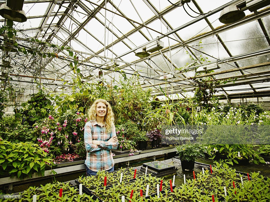 Smiling female botanist in research greenhouse