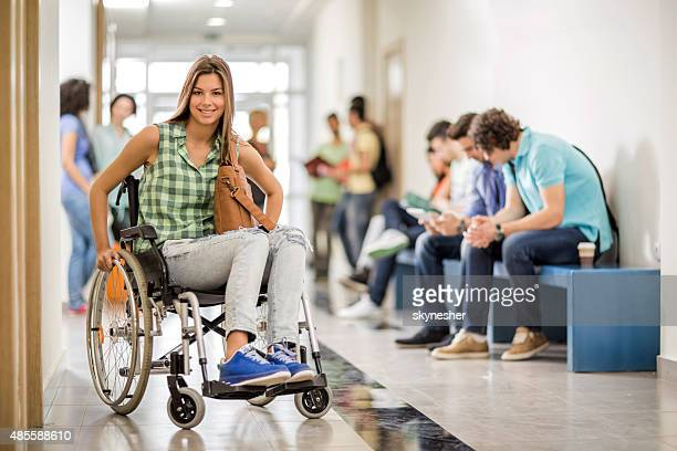 Smiling female college student in a wheelchair looking at camera
