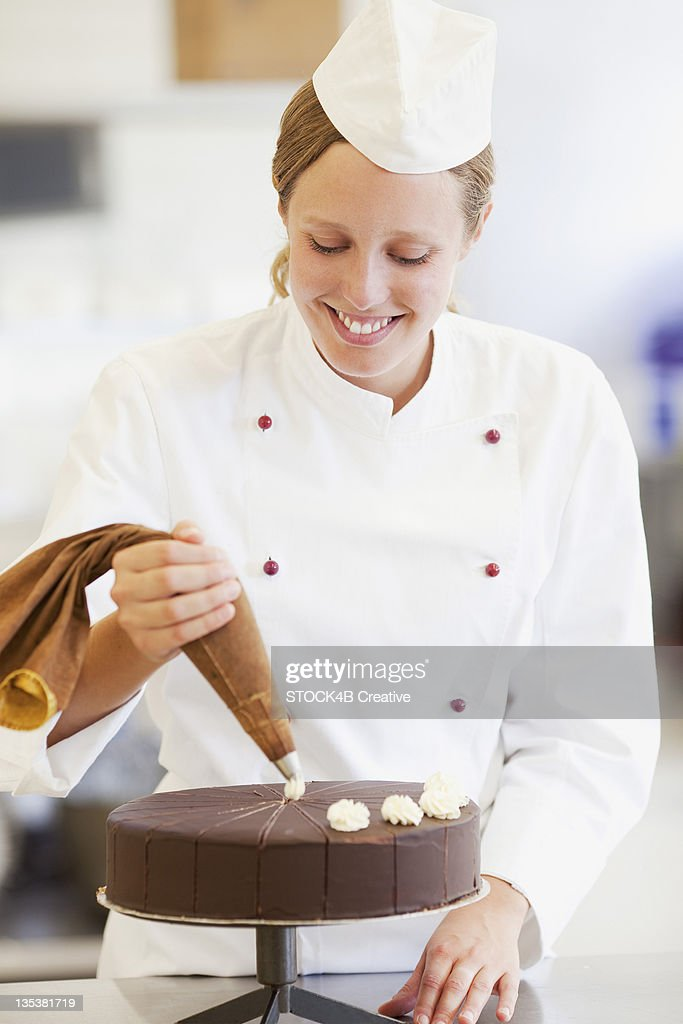 Smiling female confectionist working