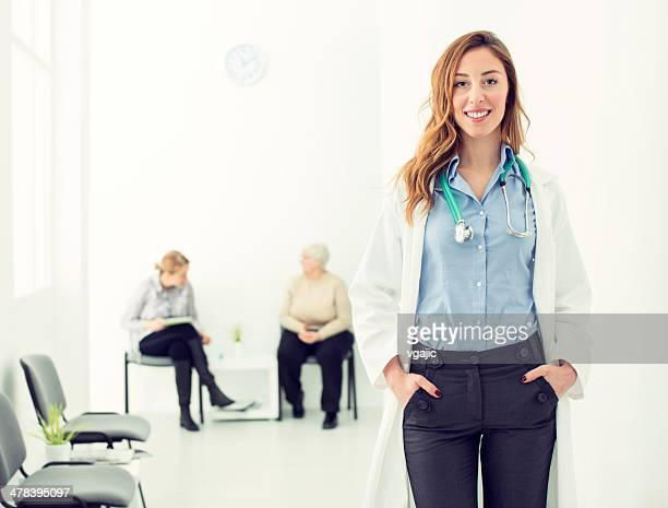 Smiling Female Doctor in a hospital corridor.