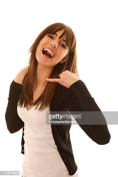 Smiling female doing call me gesture