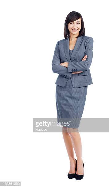 Smiling female executive with arms crossed