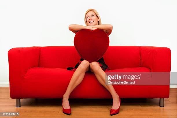 Smiling female holding a big heart shape