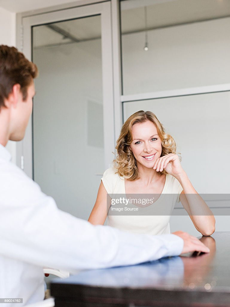 Smiling female office worker with colleague : Stock Photo