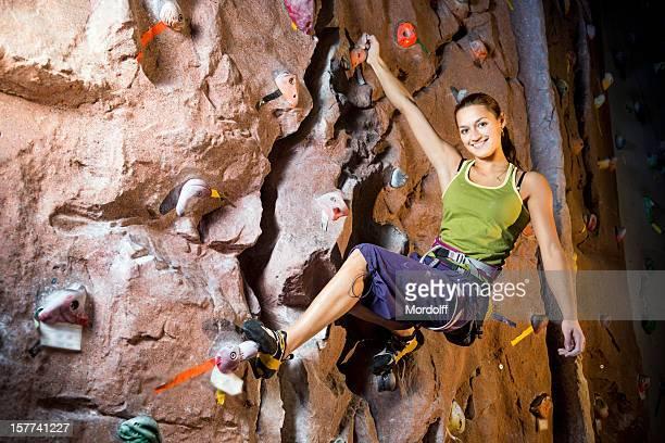Smiling female rock climber