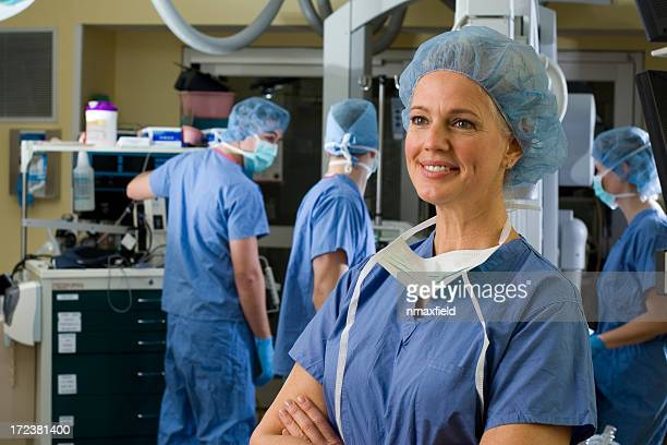 Smiling female surgeon in scrubs