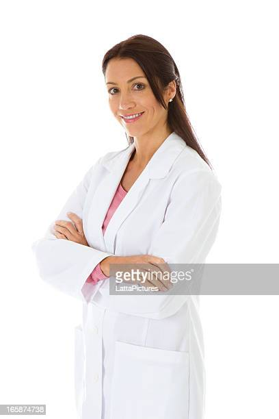 Smiling female wearing labcoat arms crossed
