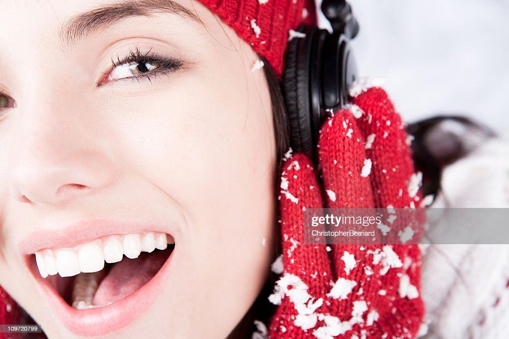 Smiling female with headphones : Stock Photo