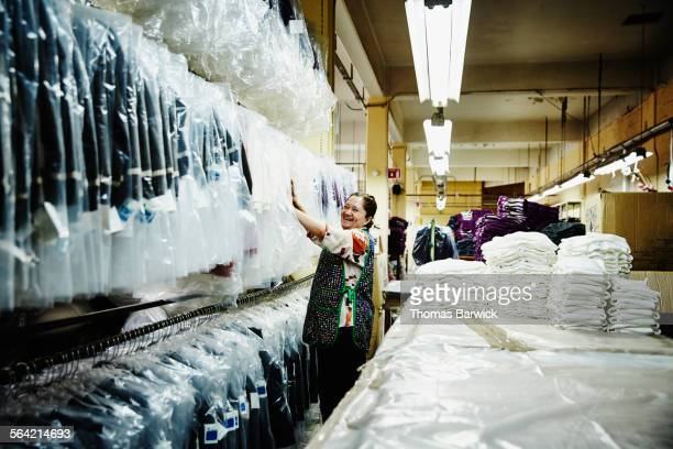 Smiling female worker in garment factory