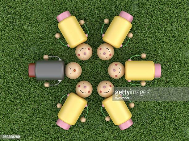 Smiling figurines lying in circle on grass with one unhappy among them