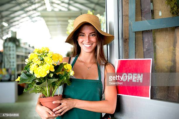 Smiling Florist in her Store