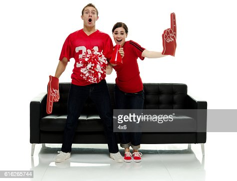 Smiling football couple being excited : Stock Photo