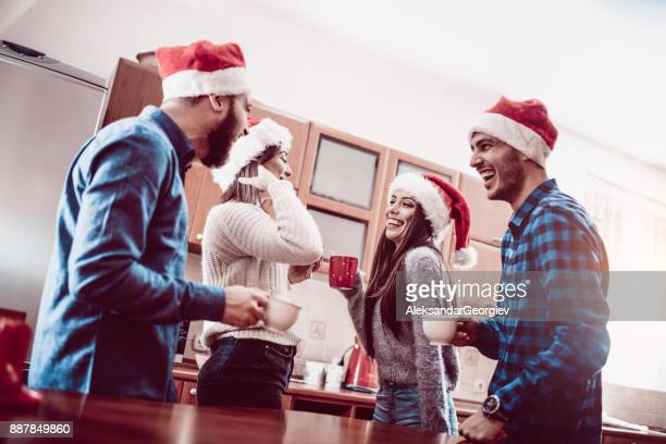Smiling Friend Talking and Drinking Hot Cocoa at The Christmas Party
